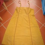 Apron dress with plaits